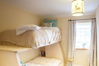 Carriage room with sumptuous extra wide, extra long single mattress with adult comfort in mind.