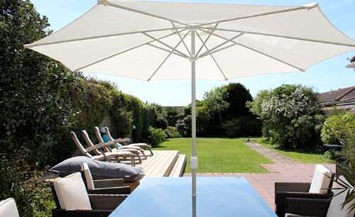 South-facing sun-trap terrace and walled rear garden that is securely gated and ideal for children to play in safety