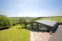 View of outside of swimming pool building - countryside views included!