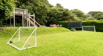 Communal play area with football goals, trampoline and table tennis table