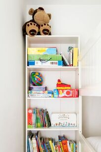 Books and toys in bunk room