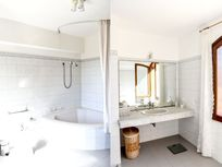 Two views of the main bathroom