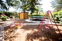 Playground with huge trampoline, mud kitchen and further equipment.