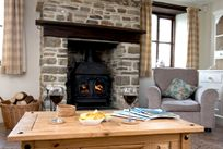 Log burner and a cheeky glass of wine!