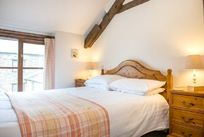 One of the double bedrooms upstairs in Bluebell Cottage