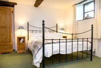 Downstairs characterful double bedroom in Bluebell Cottage