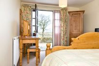 Double bedroom with views outside to a lovely courtyard and views over the countryside