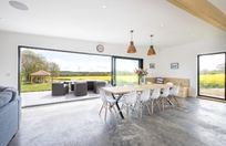 Spacious dining and living area with bi-fold doors out onto the patio