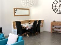Dining area with seating for up to 6 people, high chairs also available