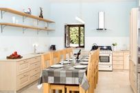 Kitchen with ample space, three high chairs and toddler chair available