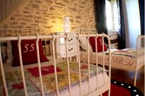 Adjustable kids beds with built in side protectors, or cots can be popped in!