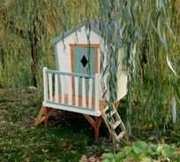 The playhouse is tucked beneath the willows alongside the games room, close to the pool area and the play lawn.