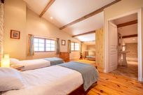 Petit Chateau upstairs twin bedroom with en-suite & fixed wooden cot