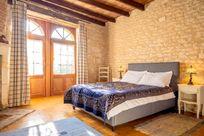 Petit Chateau downstairs bedroom with en-suite