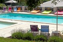 lots of colourful sunbeds around the pool