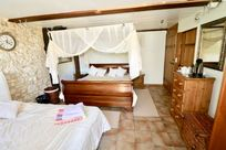 Ground floor Sleigh bed in the Green Suite which has an en suite shower room.