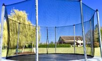 Super size trampoline, enclosure and steps in the flat, enclosed 2 acre garden.