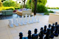 Play a game of outdoor giant chess on the Green terrace next to the heated pool.