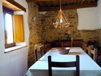 STONE WALLED DINING ROOM