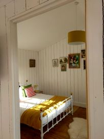 The main bedroom has a king bed and there is space in this room for a travel cot