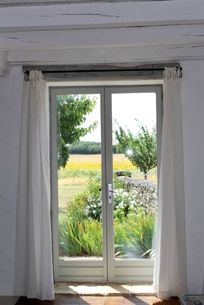View of the garden through the lounge french doors
