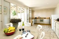 Fully fitted kitchen / diner with french doors to large terrace