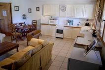 Drake Cottage Kitchen area over looking the front garden towards the duck pond A sink with a view!