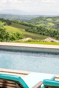 View from the pool over vineyards and olive groves