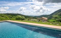 View from the Casa San Gabriel pool, over vineyards, olive groves and a truffle wood.