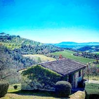 Stunning views from La Stalla down the valley over vineyards, olive groves and farmland