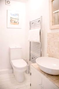 Bathroom with heated towel rail