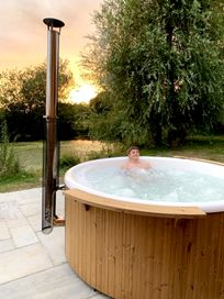 Wood fired hot tub overlooking our lake