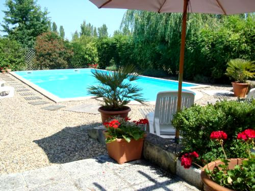 The secure 12m x 6m pool with raised deck area and plenty of shade