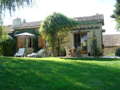 Duck Cottage garden terrace with views over our 4 acre parkland and pool