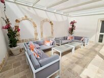 Covered outdoor seating area for  the cooler evenings