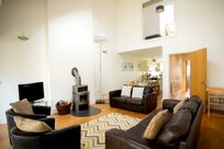 Tall ceilings, log burner and open plan living area