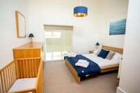 The upstairs master bedroom with en suite