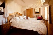 First floor Rose Suite has a double bedroom with a single bed also plus a smaller room with a single bed and cot