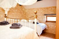 First floor Yellow Suite Main bedroom with a child's bed plus room for a cot