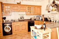 The kitchen is extensively equipped with Le Creuset, Joseph Joseph, Bosch plus a SMEG oven