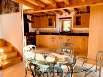 The Barn has oak ceilings and Italian travertine flooring with granite kitchen work surfaces