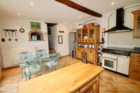 The Farmhouse kitchen has a Range master stove plus views over the pool area