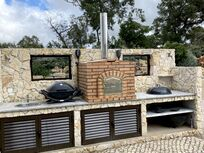 BBQ area with charcoal webber, pizza oven and gas BBQ