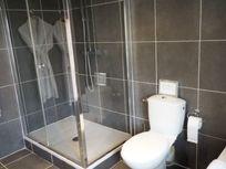 parents' ensuite shower, bath, WC and basin