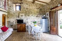 Downstairs was originally where the cows lived but has now been converted into a sitting / dining area for the family