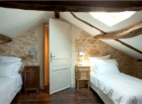 Attic bedroom with 2 single beds