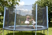 Happy kids with our trampoline, swings and sandpit