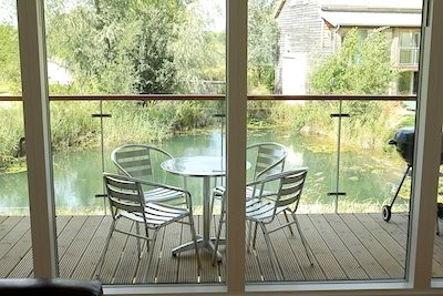 The enclosed balcony and trout pool