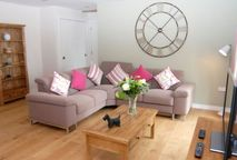 Open plan dining, kitchen, living area with double sofa bed