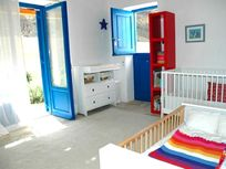 Kids' room can be set up as bunk beds or singles, and even an infant cot
